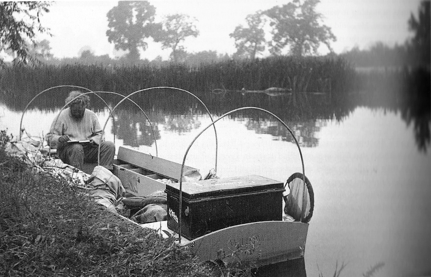 Gibbings making notes in his boat the 'Willow' on his journey down the Thames in 1939, RUL.
