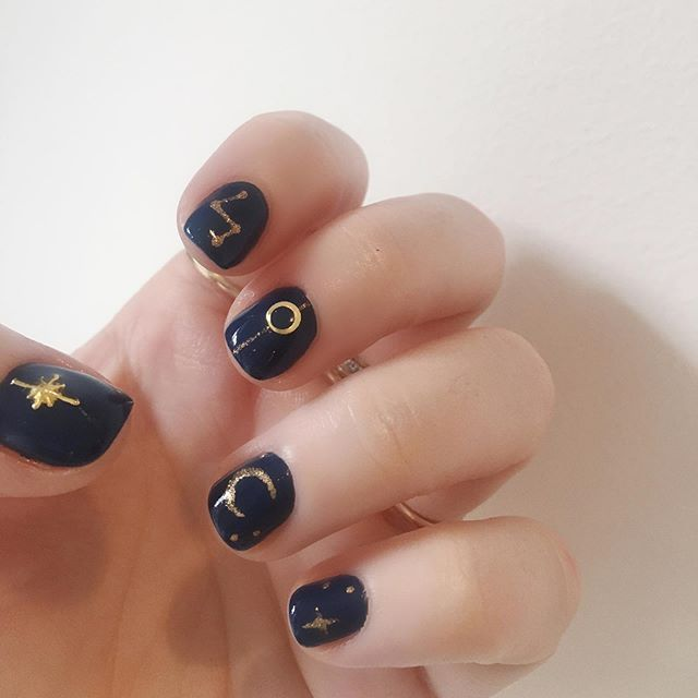 Thanks for all your votes!Option 6 won by a mile but I chose to take the astrology-esque symbols and put them on a navy base instead of nude as it felt more autumnal! What do you think? The brilliant @noormaxime @lakwerk creates this look. You can see option 6 in my stories if you want to see what I based this on :) . . . #nailsofinstagram #nailart #lakwerk #lakwerkamsterdam #manicure #mani #navynails #goldnailart #goldnailartdesign  #nailartideas #nailartinspiration #nailartinspo