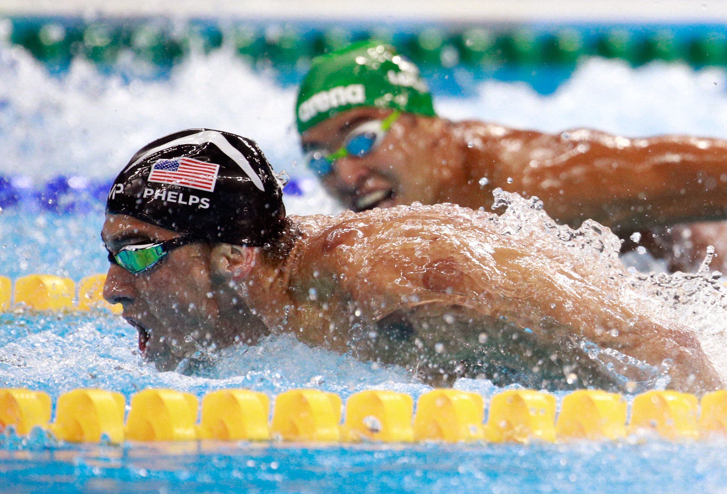 Michael Phelps and Chad Le Close - Photo: Bustle