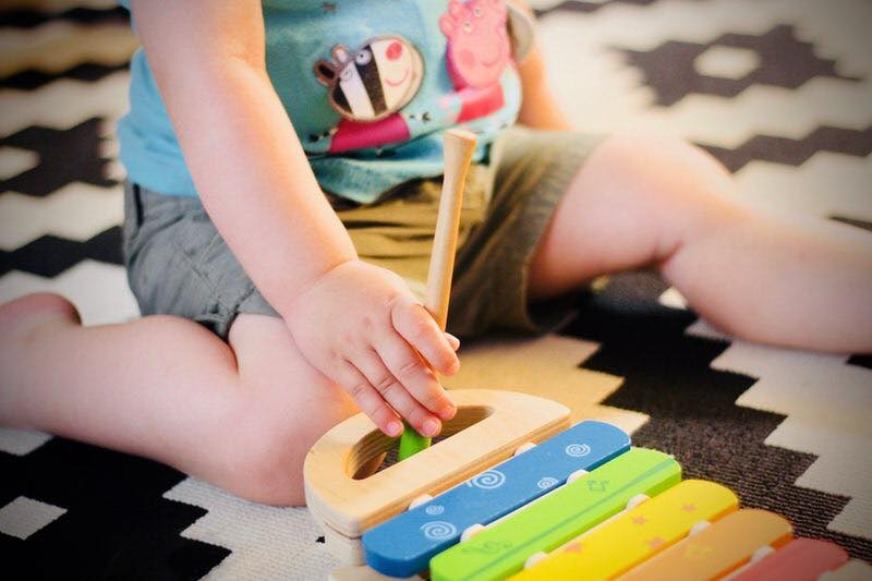 baby with music toy.jpg