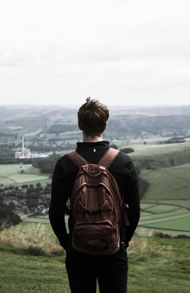 boy with backpack overlooking ridge.jpg