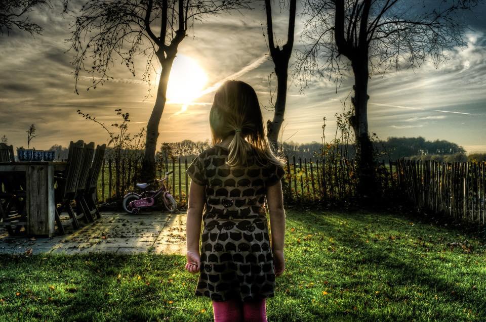 Little girl in yard.jpg