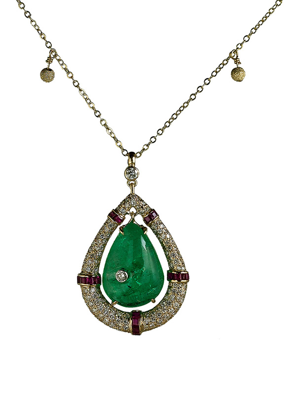 Cabochon Emeralds, Surrounded with Rubies and Diamonds on a Gold Chain with Gold Pom Pom Balls