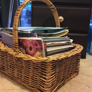 My writing basket, full of notebooks and scraps of paper I've written ideas on over the years.