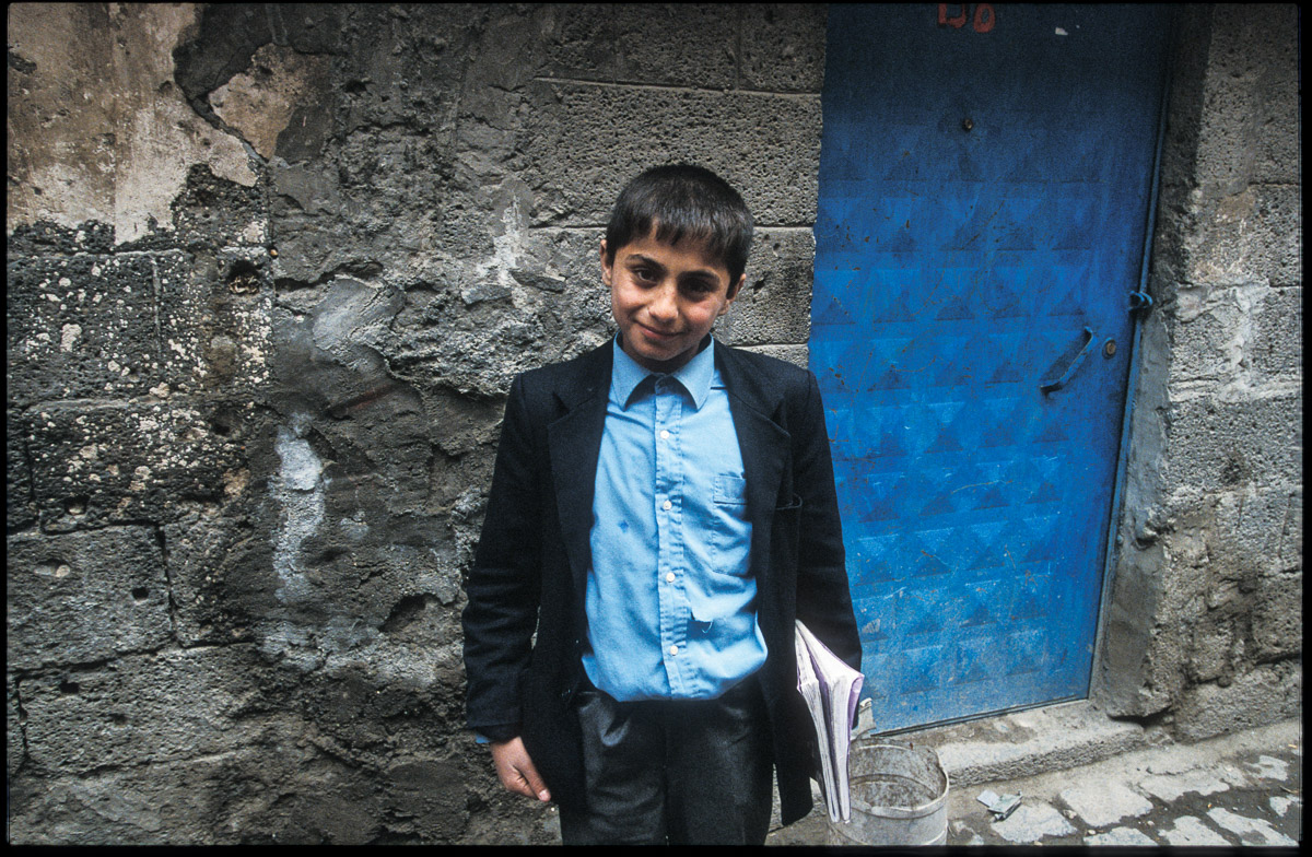A Kurdish boy poses before going to school in the streets of Diyarbakir, South East Turkey.