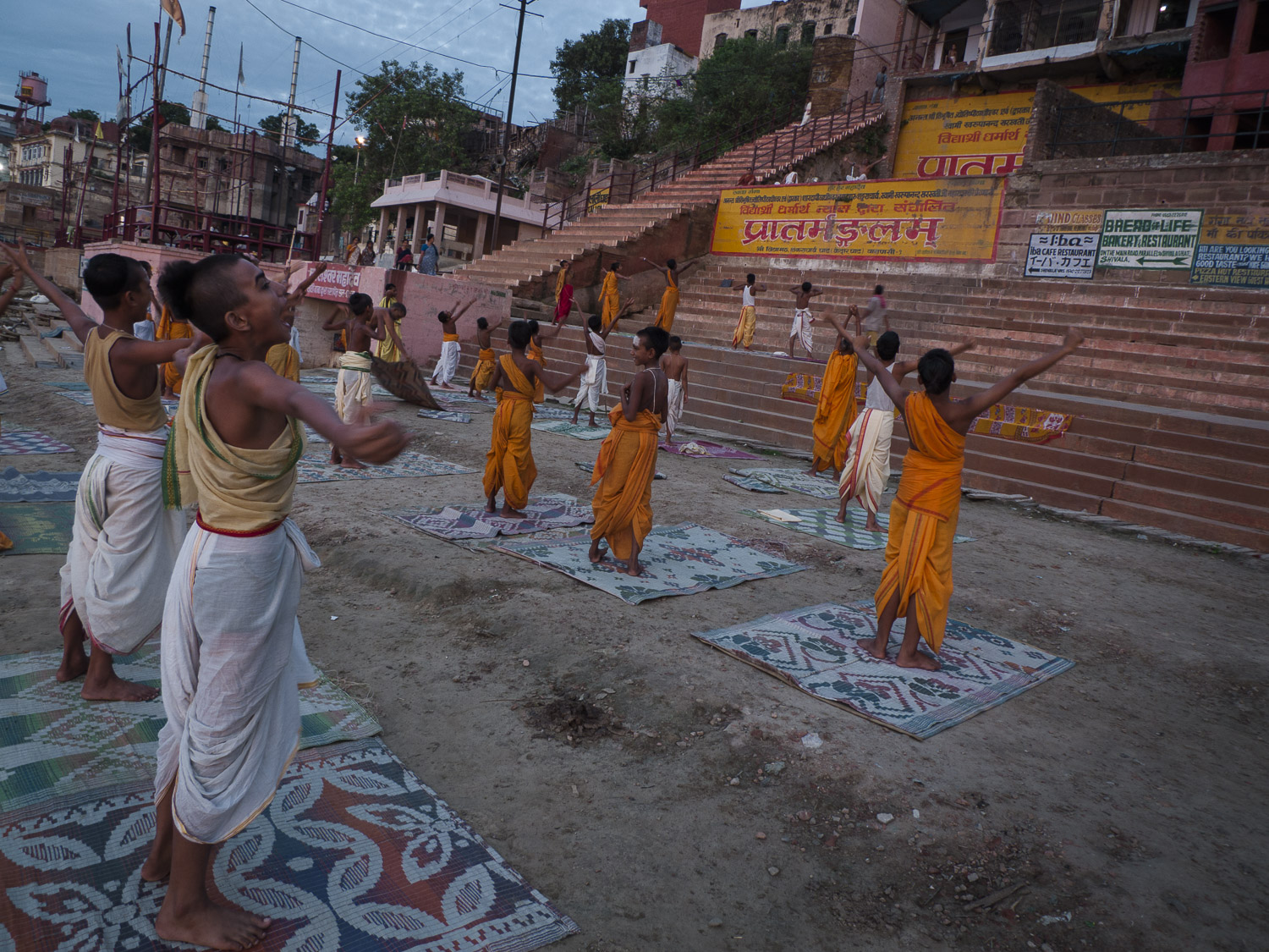 Hindu's pratice yoga on the banks of the river Ganges during sunrise in Varanasi, India