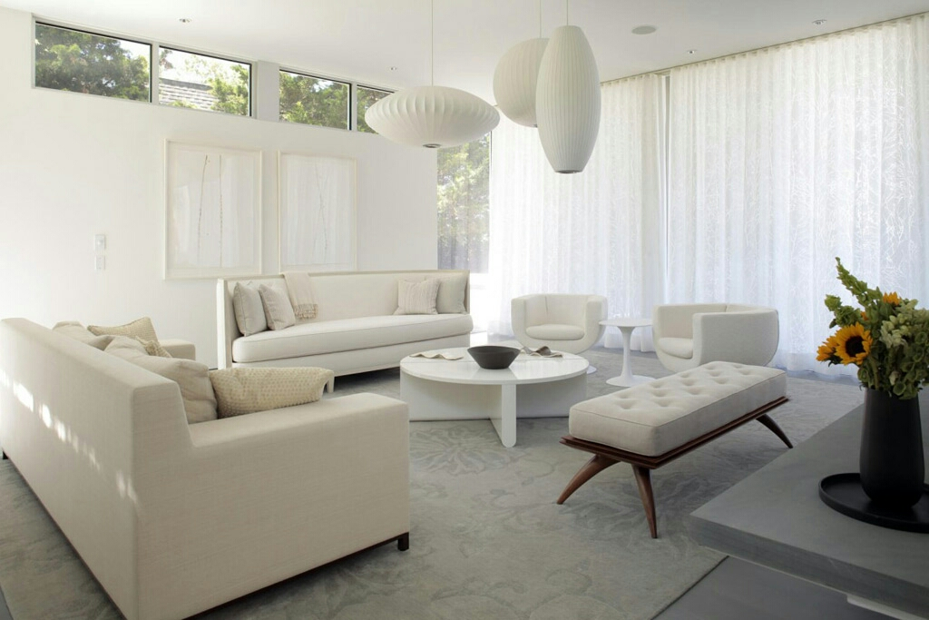 Con temporary living space in white and beige.