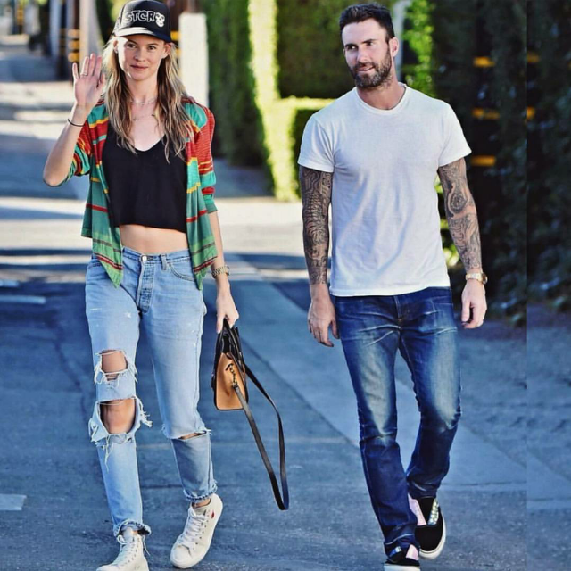 Behati Prinsloo skewed ultra casual this weekend while on a stroll with hubby Adam Levine. The model was spotted hitting her stride with a wave in  Converse x  Comme des Garcons PLAY Chuck Taylor High Top Sneakers  in beige.