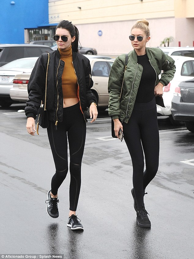 Mirror mirror: Kendall and Gigi were style sisters as they got their shopping on in   Nike     Flyknits and blacked out  Vans Old Skool Mono sneaks.
