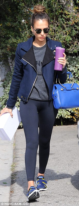 Jessica Alba wearing took to those LA streets for some shopping over the weekend. She paired her Viktor & Rolf Bombette Bag expertly with blue low top trainers.