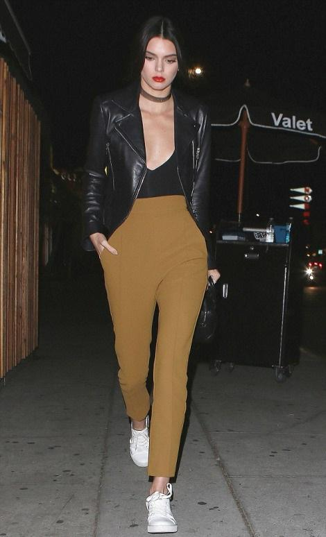 Kendall Jenner continues to WIN.   The model was spotted at The Nice Guy wearing a Balenciaga Genuine  Biker Jacket , high waist trousers and  Kenneth Cole  Kam Sneakers.