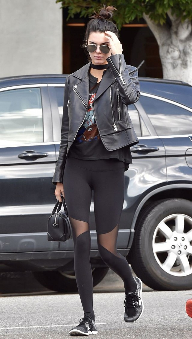 Kendall Jenner traipsed around LA in her favorite Balenciaga Genuine  Biker Jacket ,Nike Free 4.0 Flyknit Sneakers in Black/Wolf Grey/Dark Grey/White , Alo Yoga Coast Leggings in Black, Slayer 1987 Reign in Pain T-Shirt and Ahlem Republique Aviators. She's always so fly.