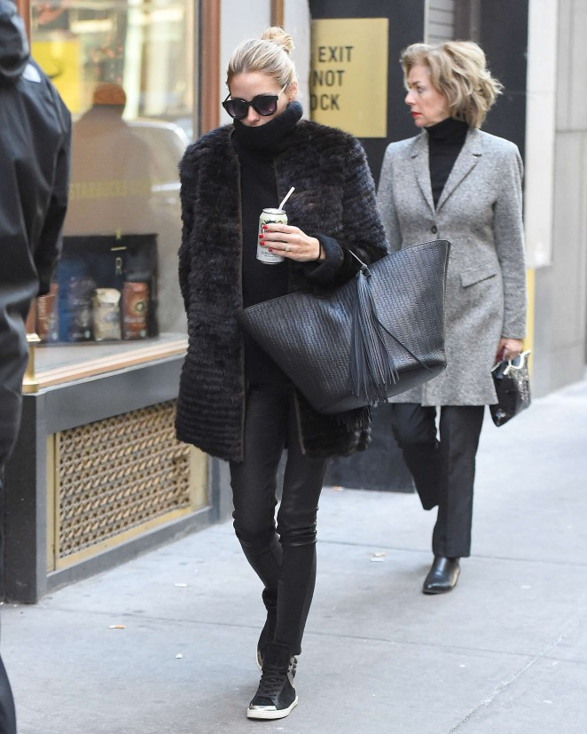 Black fur, turtleneck, leather leggings, and high-top sneakers were the move for Olivia Palermo while out and about in the Big Apple. She always looks amazing.