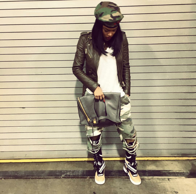 Teyana Taylor's camo queen fit was topped off with a pair of Nike Air Force 1 'Tisci'boots.