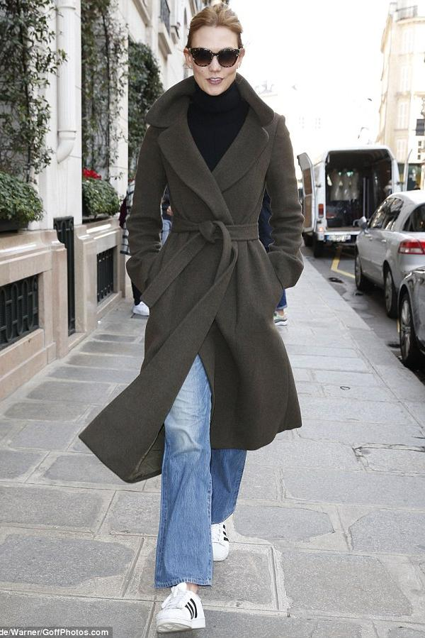 Karlie Kloss ventured out onto Paris streets wearing Adidas Originals Superstar Sneakers, a Victoria Beckham Merino Wool Turtleneck and a Cashmere and Helmut Lang Double Face Wool Coat in Bark. Tres chic!