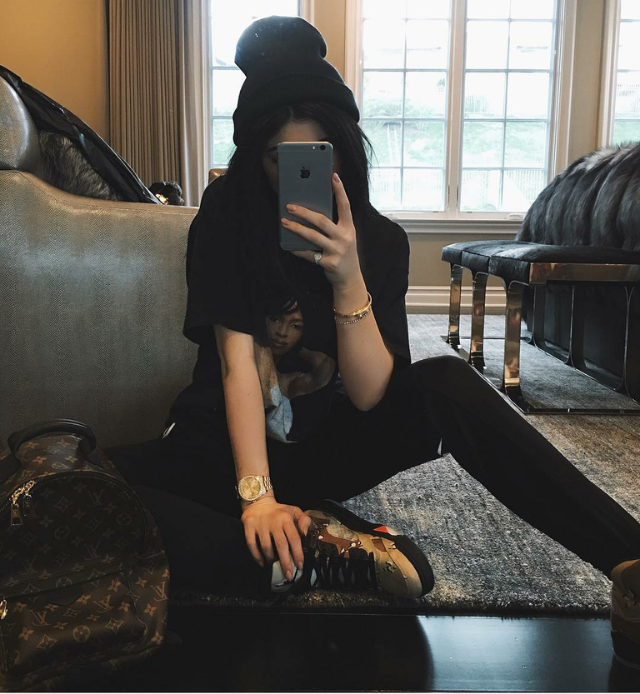 """Kylie Jenner kept her face under wraps, but as long as we can peep the shoes - right? Right. King Ky snapped away in a pair of coveted Air Jordan 5 Retro """"Supreme"""" sneaks. Camo Kylie, y'all."""