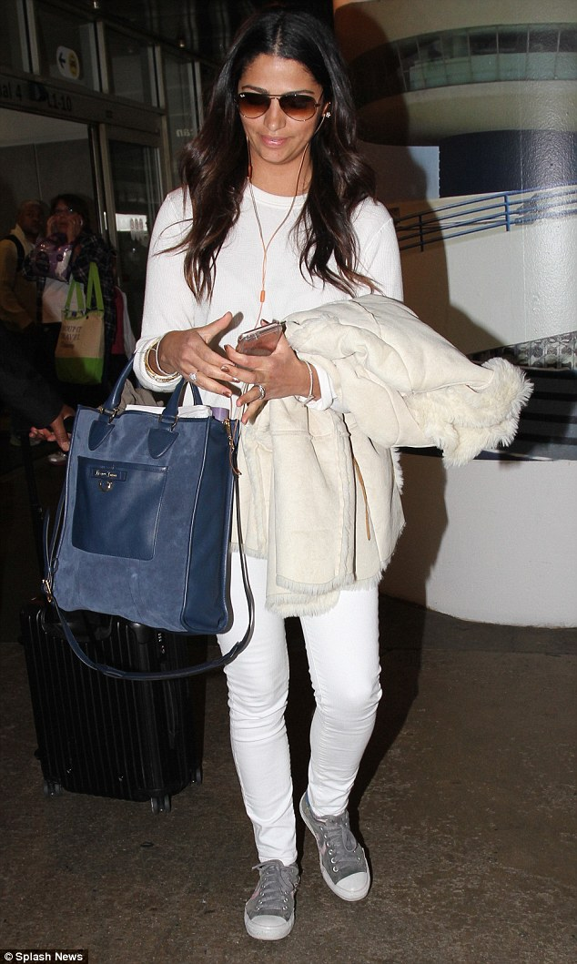 Camila Alves journied through the hallowed terminals of LAX wearing Converse Star Player Ev Sneakers in Phaeton Grey/Pink. Definitely a nice color touch with her all-white-everything fit.