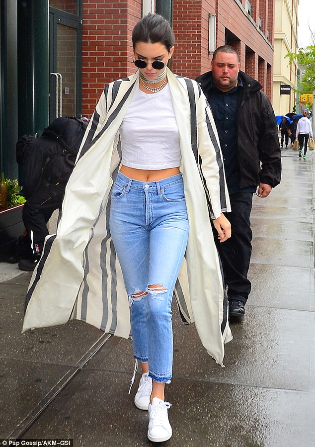 Kendall Jenner walked her way right into our minds and hearts in this casual, but cute, NYC getup. The elder KJ paired her  adidas classic Stan Smith  sneaks with  Citizens of Humanity Liya Jeans  and a  Caban Dilip Coat by Erika Cavallini.