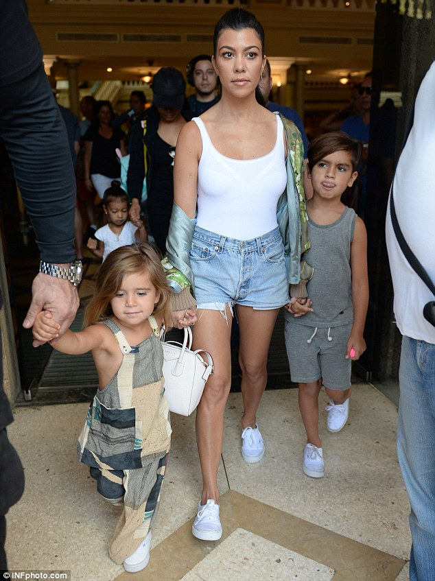 Kourtney Kardashian, also on the fam siesta in Cuba, stepped out extra cute with a Givenchy Small Antigona Tote, Vans Classics and a Gucci Blooms Print Bomber Jacket.