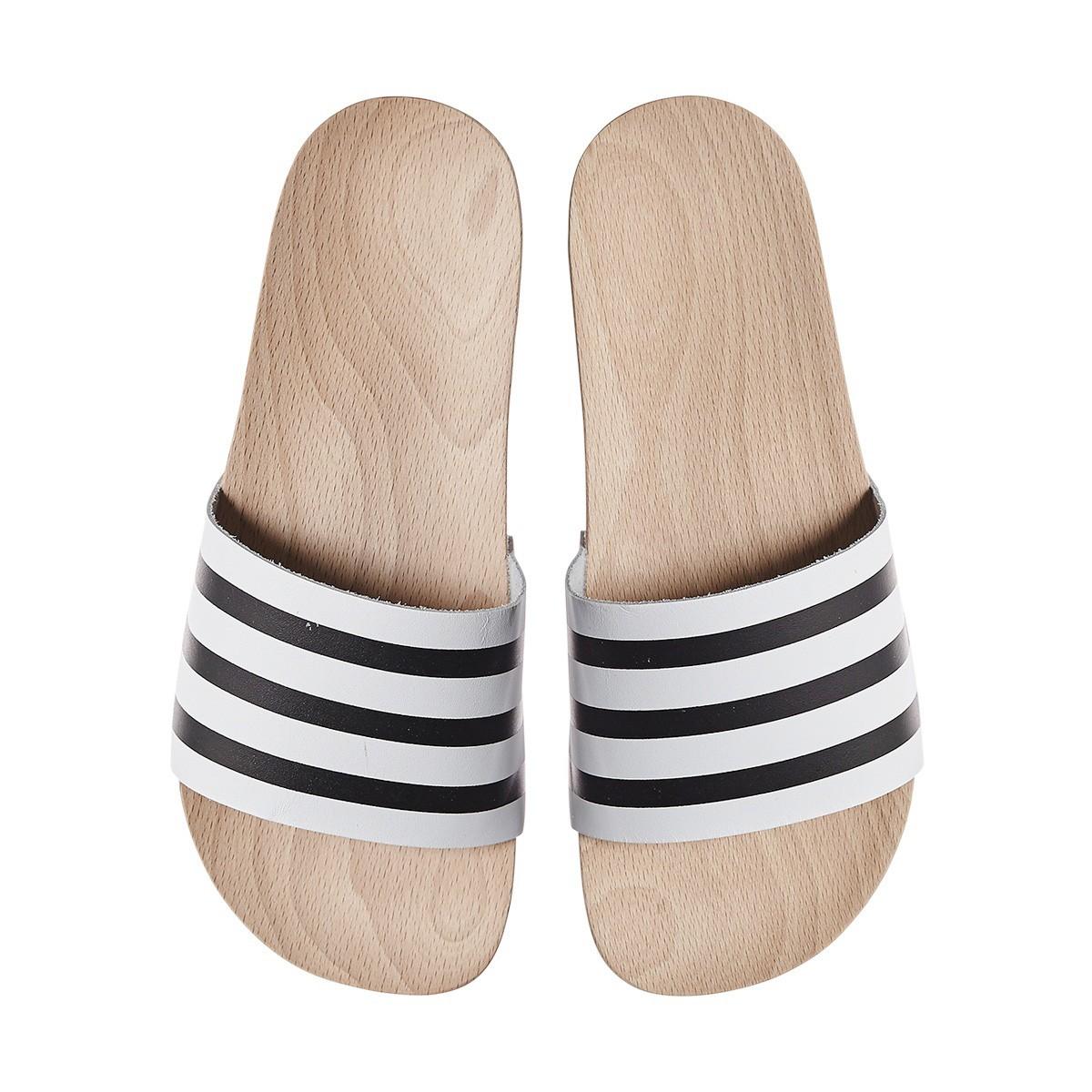 wmns-adilette-wood-slides-1.jpg