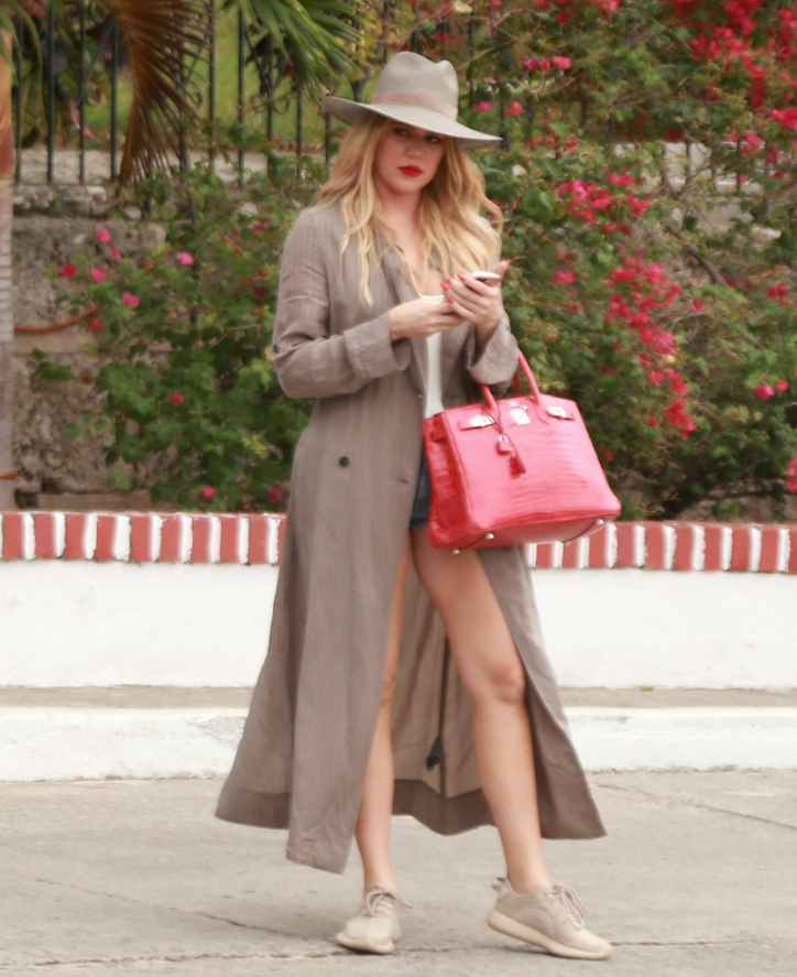 Last, but not least: Khloe Kardashian had a major Carmen SanDiego moment in adidas x Kanye West Yeezy 350 Boost Sneakers in Oxford Tan, a Janessa Leone Angelica Wide Brim Hat and  Raquel Allegra Double-Breasted Maxi Trench.
