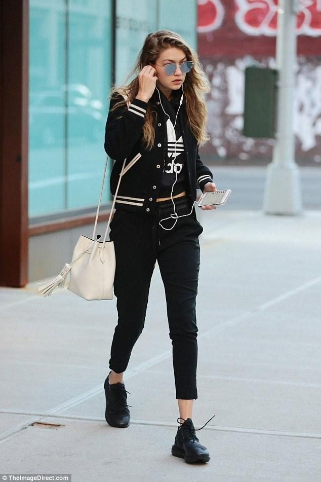 Gigi Hadid has been quite the three stripes fan as of late. The model was spotted donning  adidas Tubular Runners  paired with  Saint Laurent Teddy Bomber Jacket ,  Tom Ford Leather Small Tassel Bucket Bag ,  Gentle Monster Love Punch 02 Sunglasses  and an  Adidas Cropped Hoodie.
