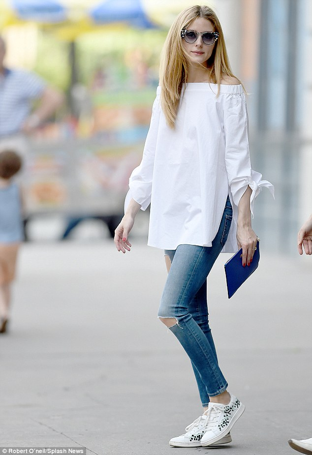 Olivia Palermo put a stylish take on her floral Moncler Gamme Rouge Muguet Sneakers with a Tibi Satin Poplin off-the-shoulder Tunic, AG Legging Ankle Jeans in 11 Years, and a pair of TDF Fendi Galassia Marble Cat Eye Sunnies. She is always FAB.