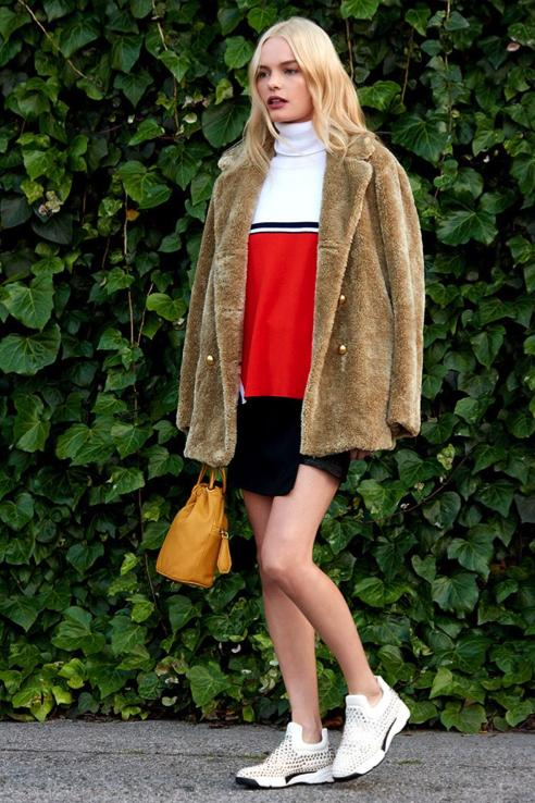 Kate Bosworth was spotted looking glam in LA rocking  Pinko Rhinestone sneakers  with a Baaria Coat, Leash Sweater, Orleans Bucket Bag and Blade Runner Skirt all by Pinko.