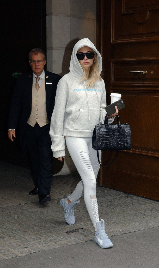 Hailey Baldwin kept a hoodie on it in Paris, making moves in a pair of  FENTY x Puma Trainers  and  Alo Moto Leggings .