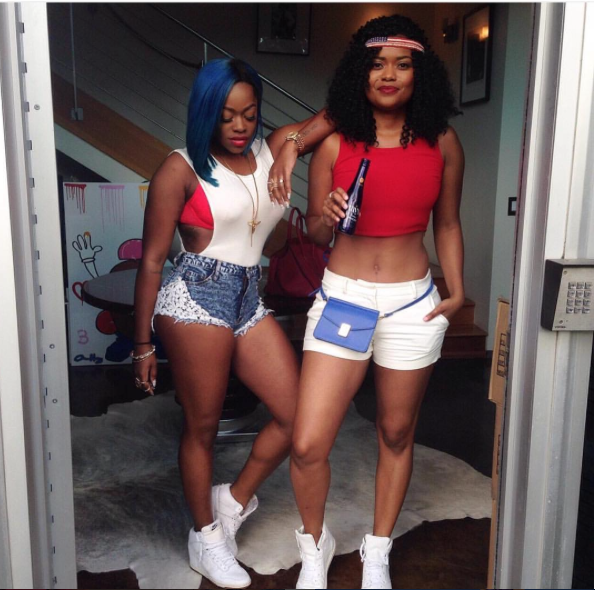 BFF beauties Karen Civil and Oloris Swank showed their patriotic love in cut offs and solid white kicks.
