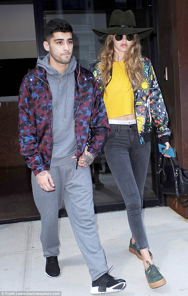 Gigi Hadid zoomed out of her NYC condo looking very boho chic in Ray-Ban Rb3447 Round Metal Sunglasses, an adidas x Pharrell Williams Artist Printed Blouson Jacket and Puma by Rihanna Women's  Green-Bordeaux Creepers.