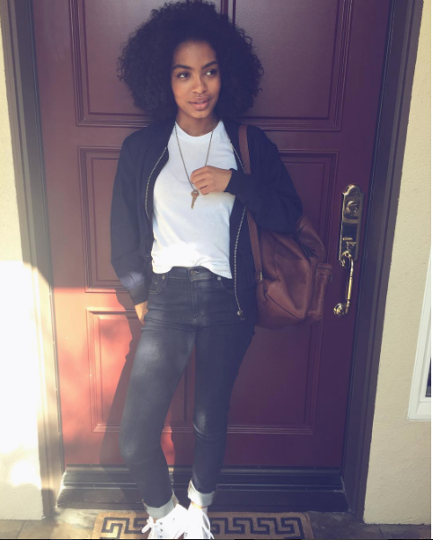Actress Yara Shahidi stepped out super cute in rolled skinnies, a simple white tee, and a pair of  Converse Classic high top sneakers . Love her.