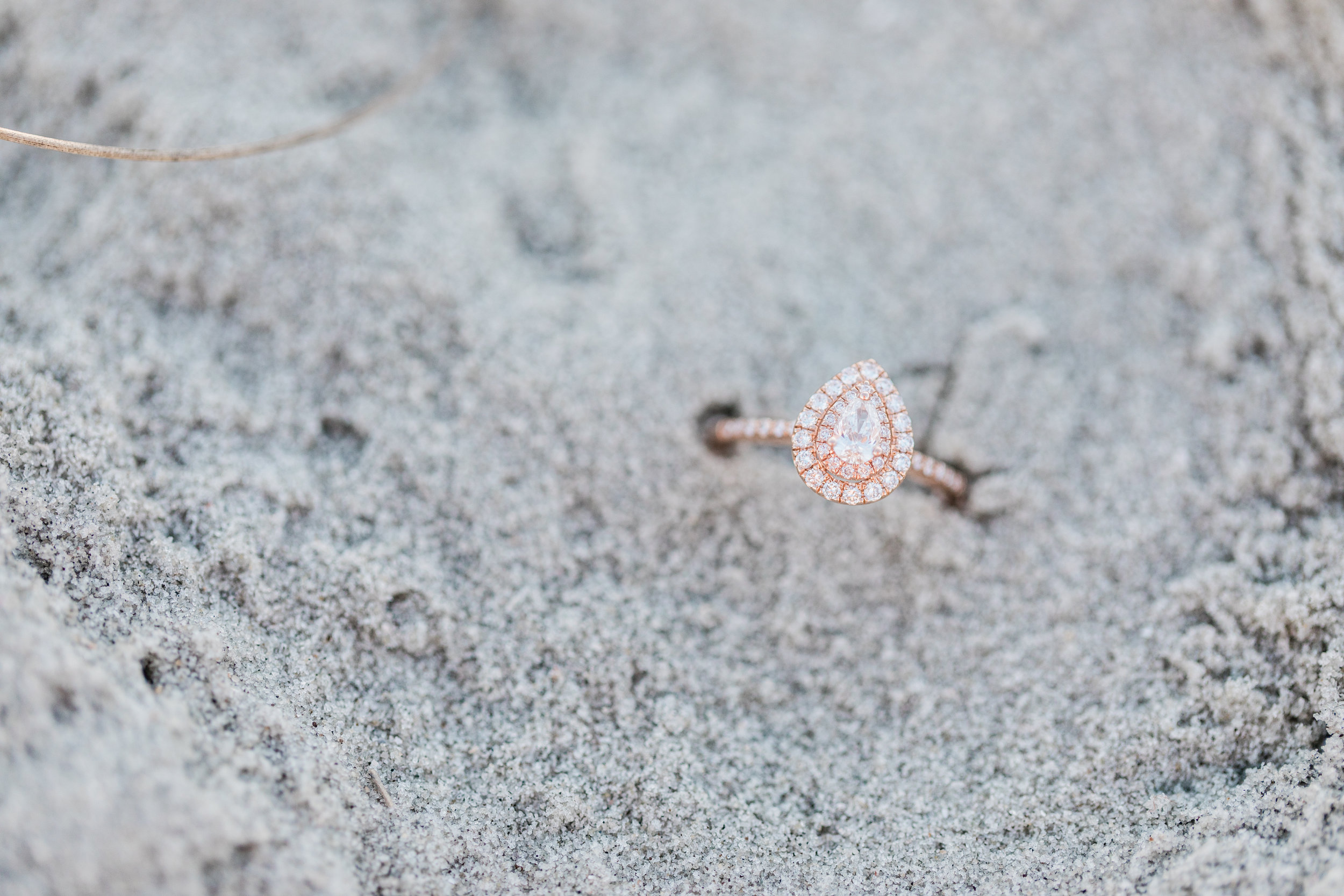 Engagement ring in sand.jpg