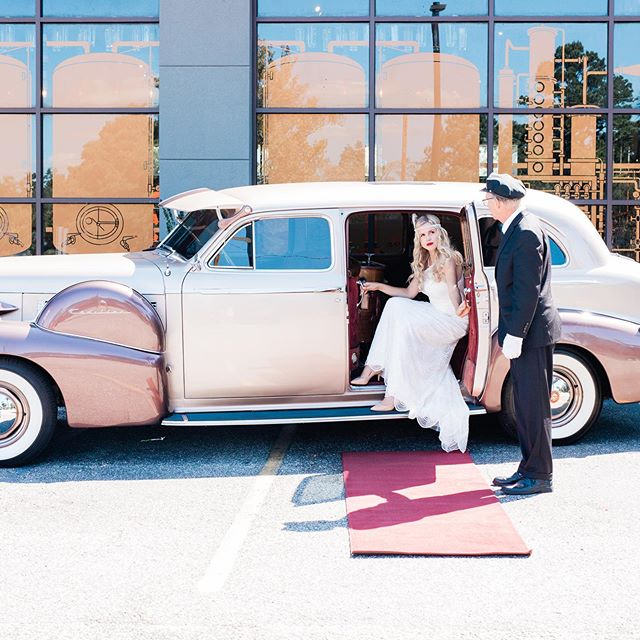 Can't wait to show you more!! _ _ We partnered up with @twelve33distillery - who has opened their doors to weddings & private events!  _ _ Not to mention, this Cadillac who drove from Columbia, SC to bring you this vintage scene!  _ _ Planning | @eventsbysantana  Venue | @twelve33distillery  Photography | @hannah_ruth_photography  Florals | @royaldecormb  Dress(es) | @thedressingroom_pawleys  Hair & Makeup | @blushandveil  Suit | @menswearhouse  Rentals | @eventworksrentals  Linen | @cdlinen  Cake | @buttercreamcakesandcatering Videographer | @naproductions