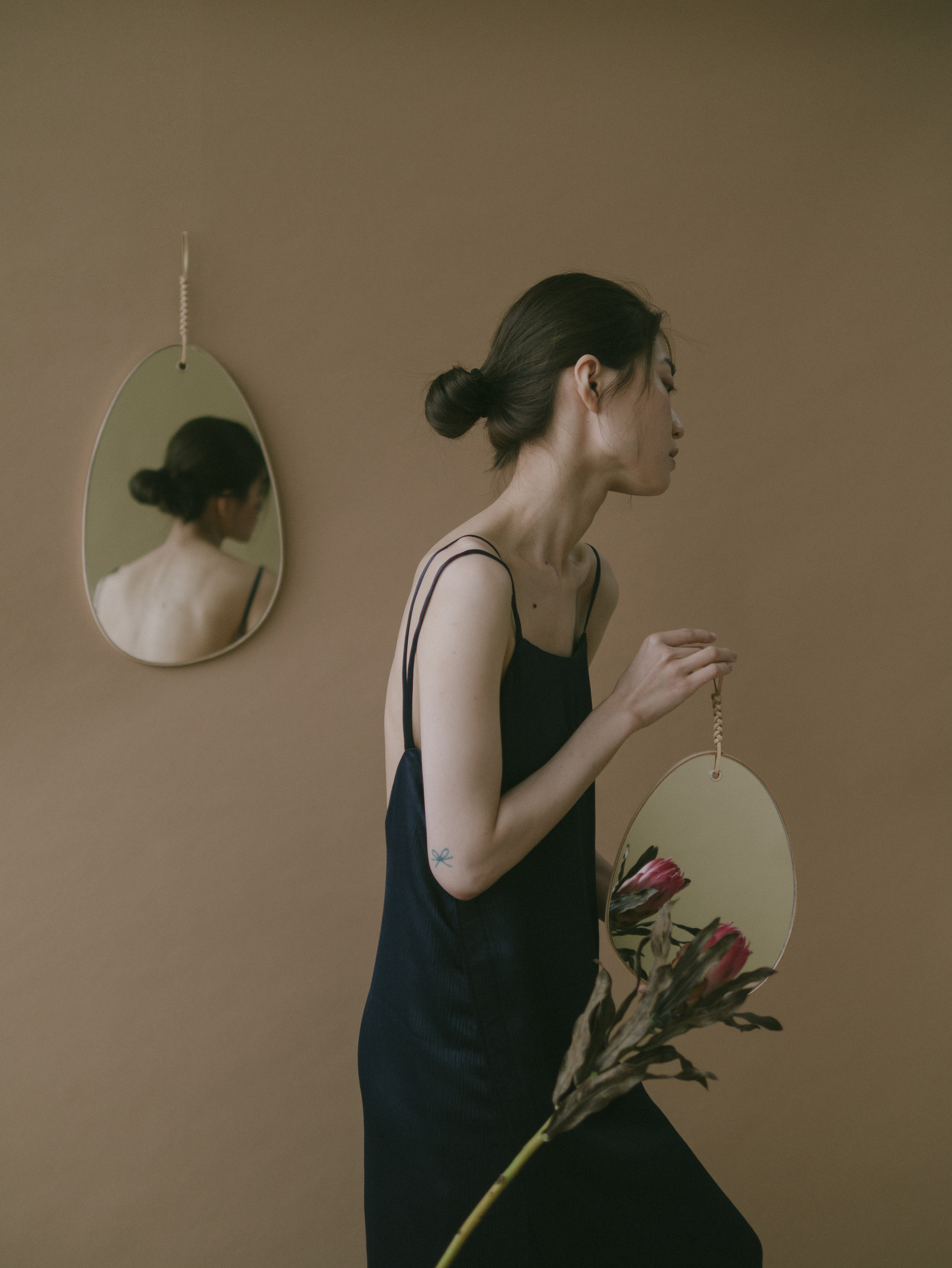 """Looking at herself in the mirror, she said """"be yourself, and let other animals do themselves. it will be a better, more elegant, more soulful behavior."""" - Woven Pebble MirrorThe strong woven knot firmly hangs the pebble shaped mirror, beautifully lives in harmony with the natural lines."""