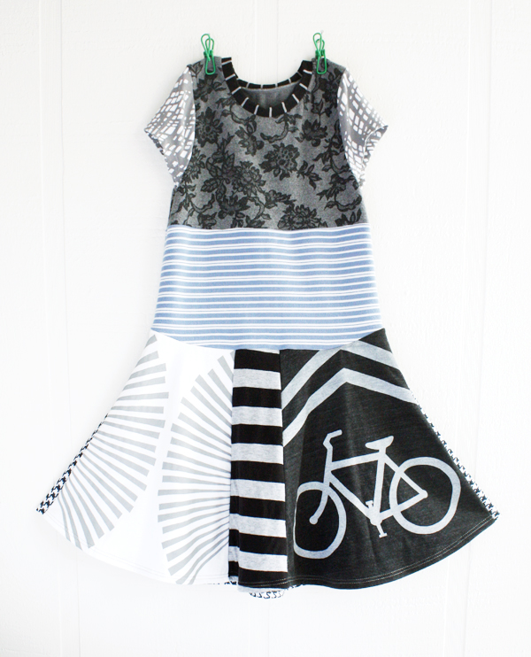 "8/10 blackbird/bicycle/bw    Size 8/10 ~ 30"" long, 13"" across chest at underarm.    Back skirt of dress is houndstooth neoprene.   * sold out *"