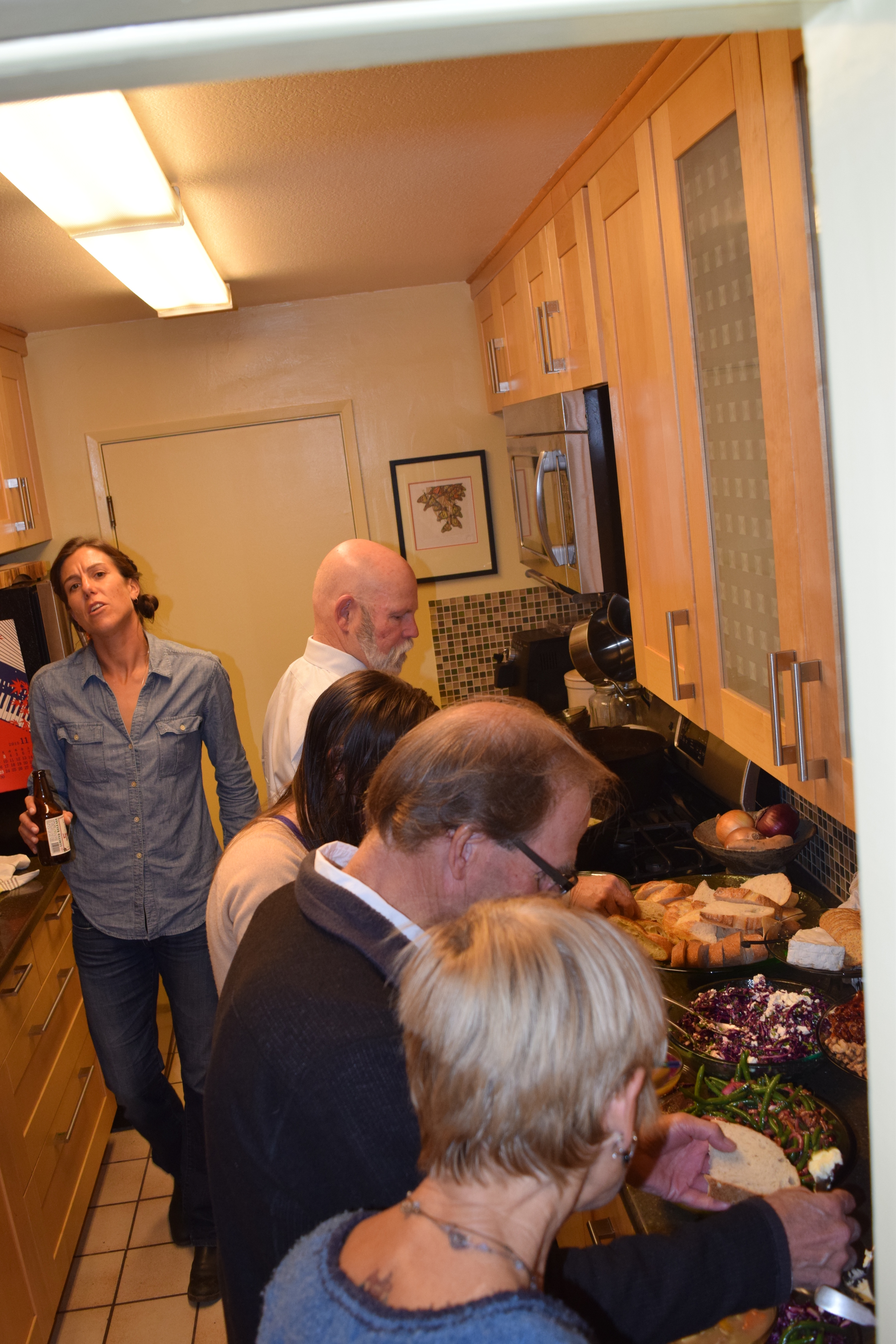 Heaven: a beer in hand; a kitchen full of food and friends! Disregard what may look like a pained facial expression.What was more likely was that I was actually singing a hymn here.