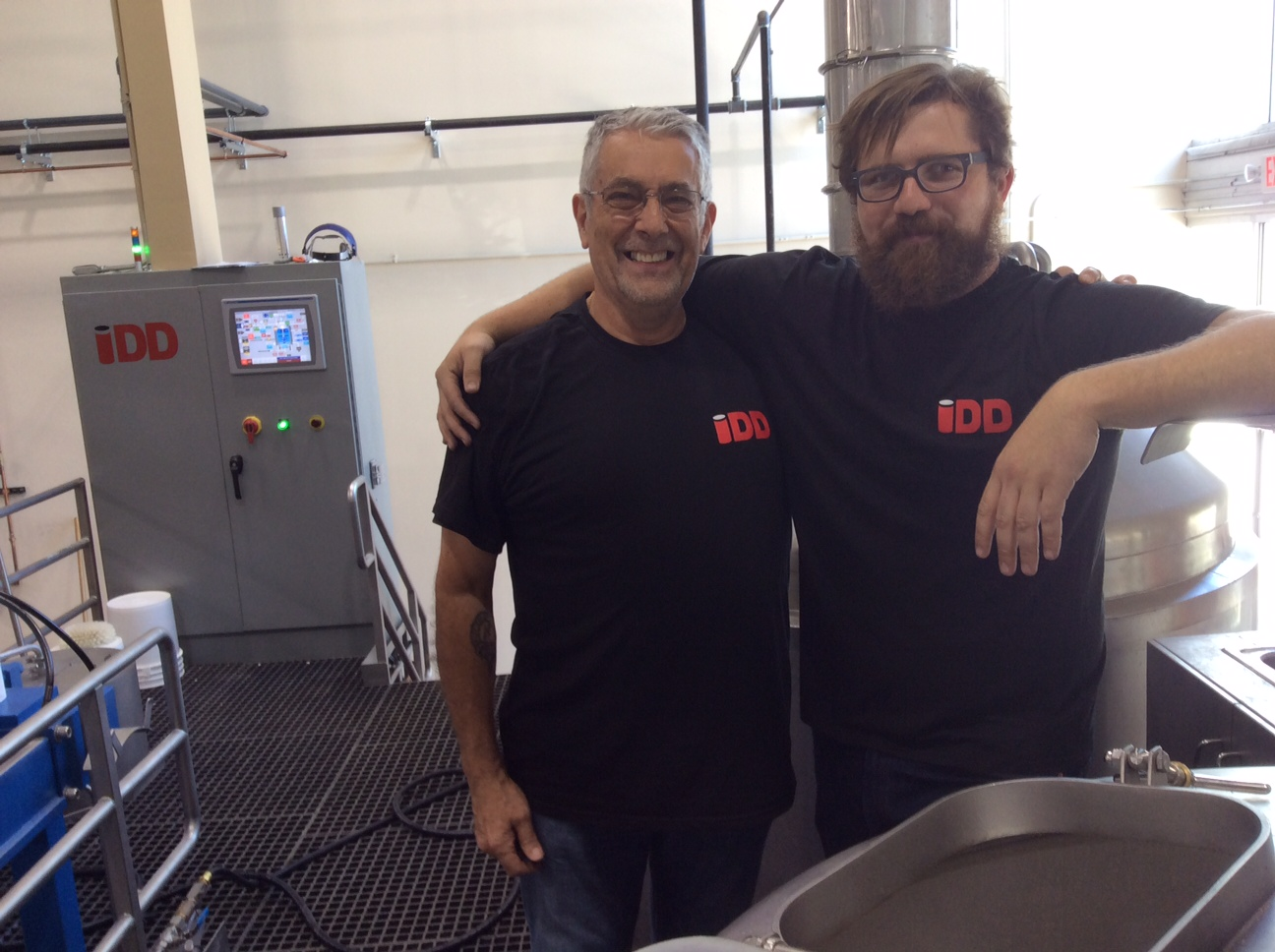Jeff Gunn, owner of IDD, the company that designed our state of the art equipment,with Matt Ducey, head brewer