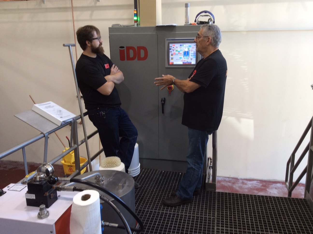 Jeff Gunn, owner of IDD, brought his crew out to help with the first brew and to make sure the equipment is working properly. Success!