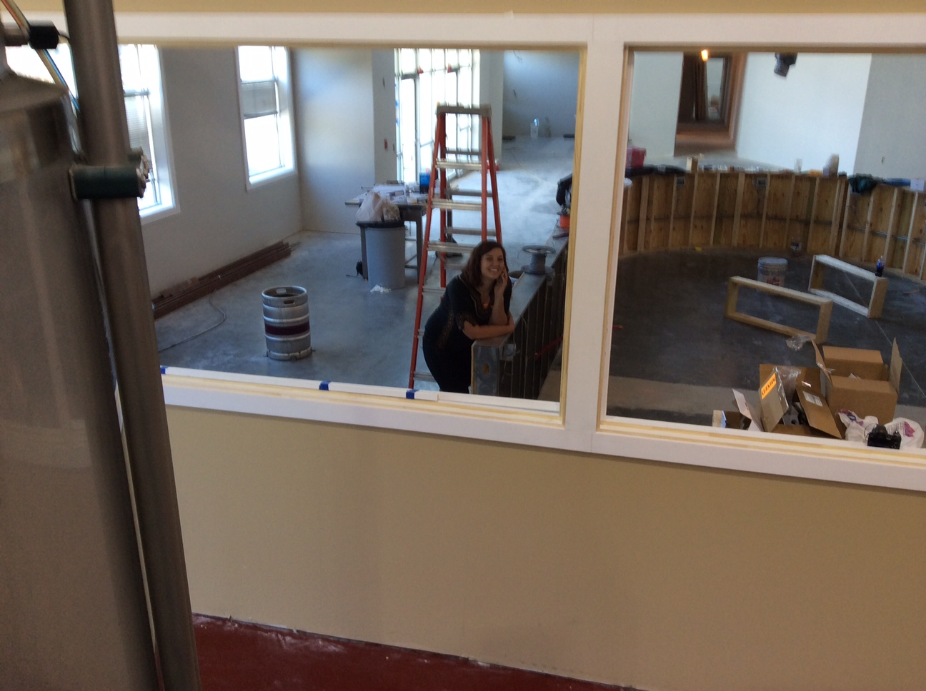 Sam Riley, Operations Director, leaning on the tap room bar. Open to the public soon!