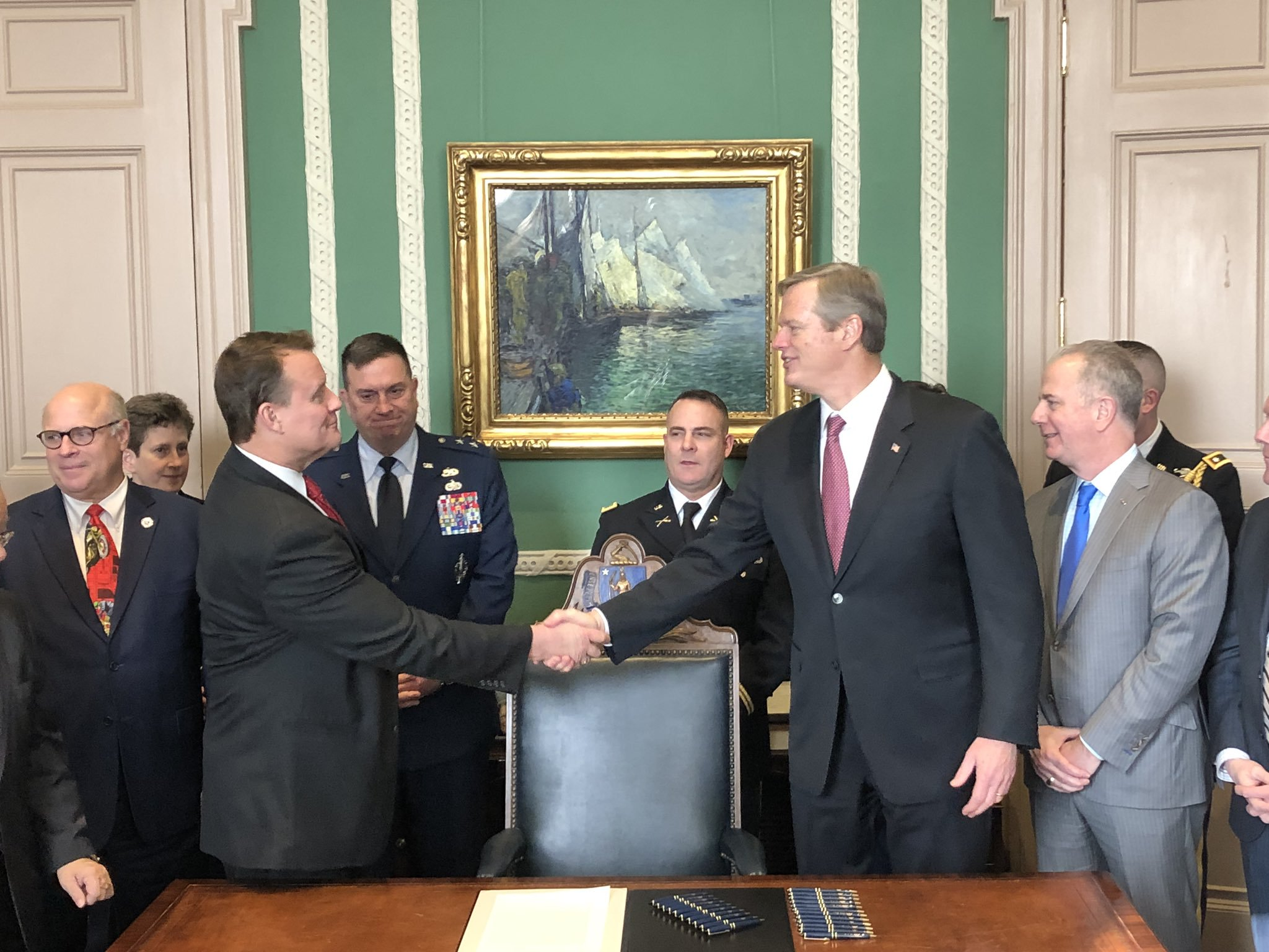 Pictured: Senator Michael Moore with Governor Charlie Baker, Major General Gary Keefe and legislative colleagues in the Governor's Office at the State House in Boston.