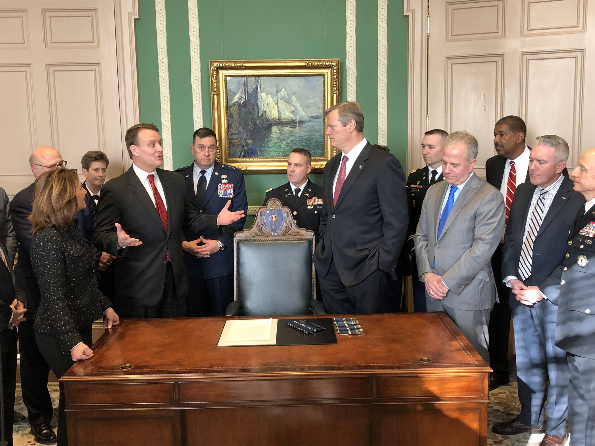 Pictured: Senator Michael Moore speaking with Governor Charlie Baker, Lt. Governor Karyn Polito, Major General Gary Keefe and legislative colleagues in the Governor's Office at the State House in Boston.