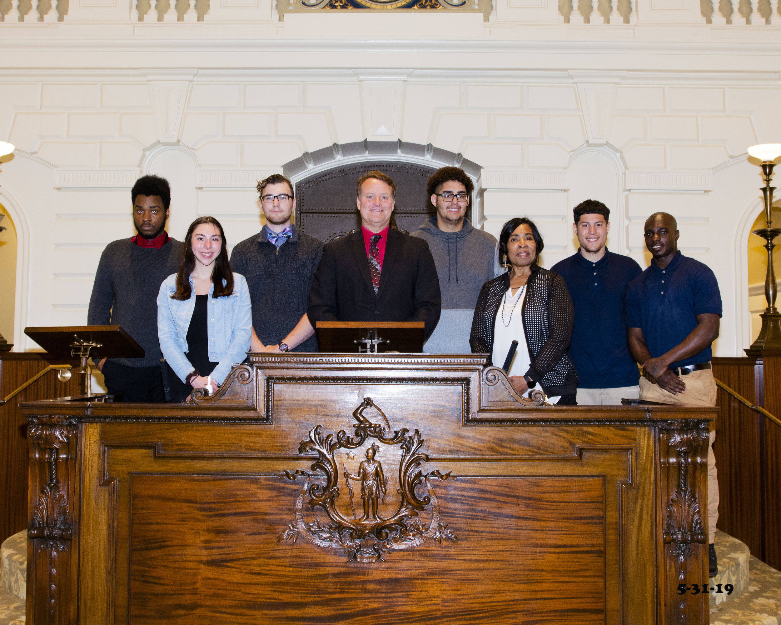 Senator Michael O. Moore (D-Millbury) with Recreation Coordinator Michelle Cook and students from the Grafton Jobs Corps on the rostrum of the Massachusetts Senate.
