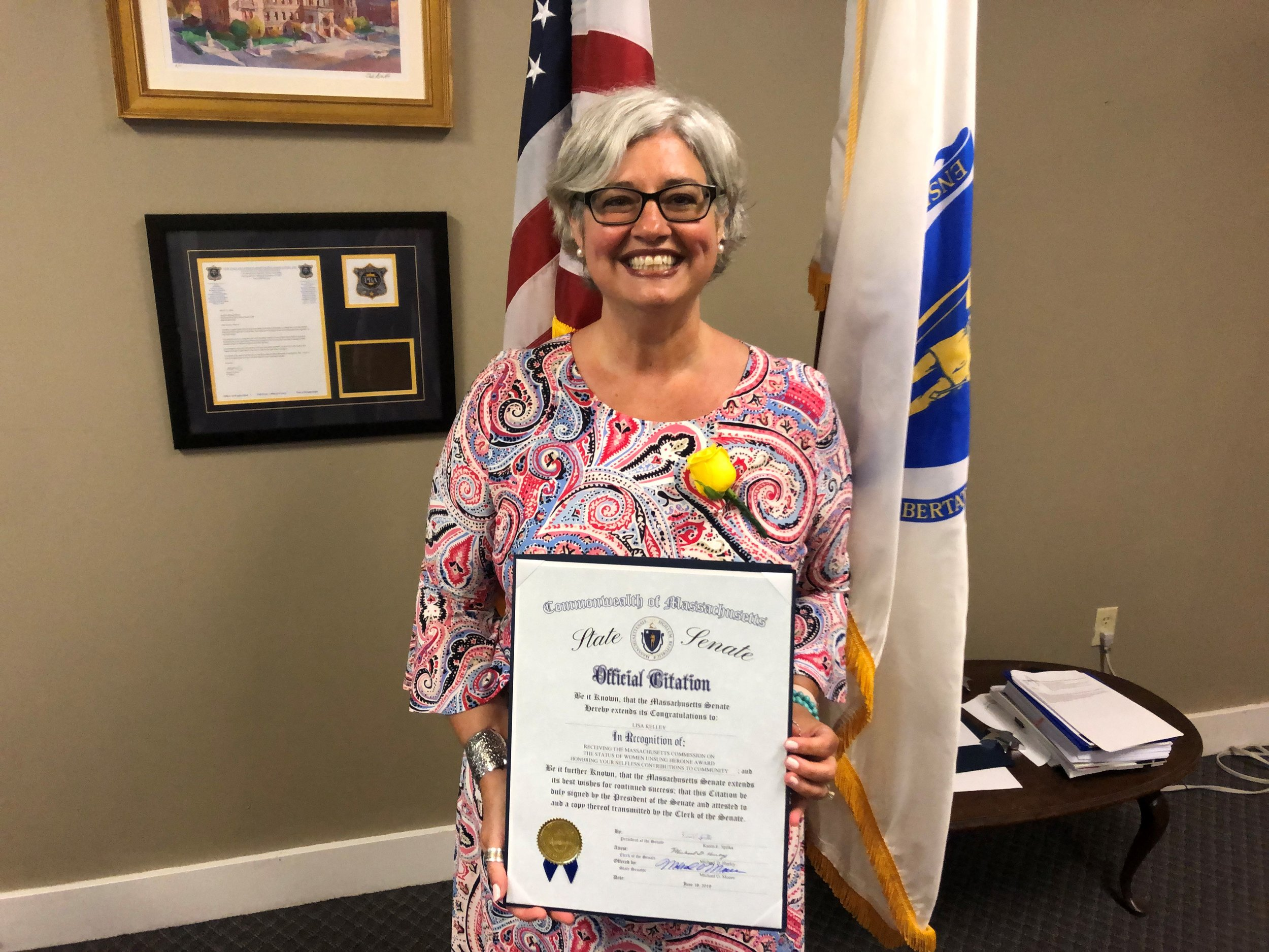 Pictured: Lisa Kelley of Grafton at the Massachusetts State House holding an official citation from the State Senate recognizing her achievements.