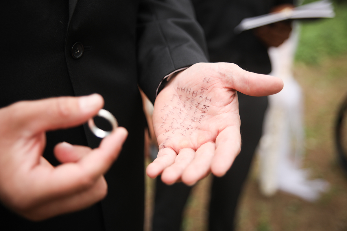Vows written on the groom's hand before the ceremony.