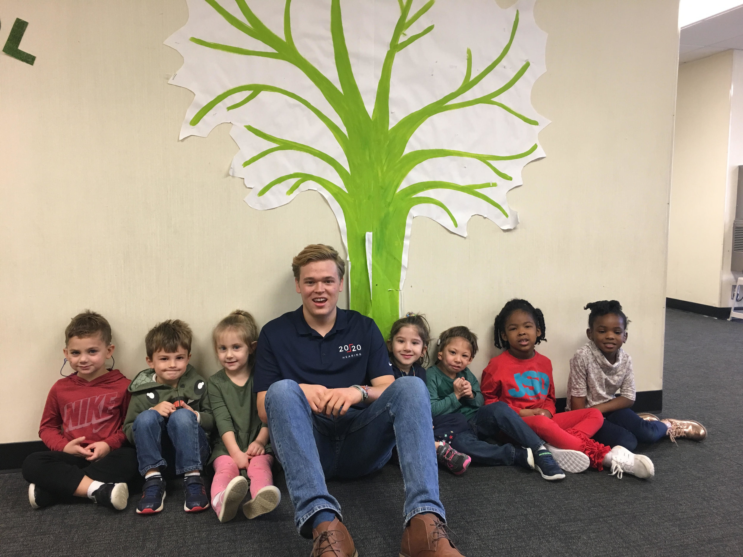 Jack with students under the Giving Tree at the Atlanta Speech School; where students write down what they have done to earn money to serve other kids in need. Such a beautiful picture of selflessness and generosity!