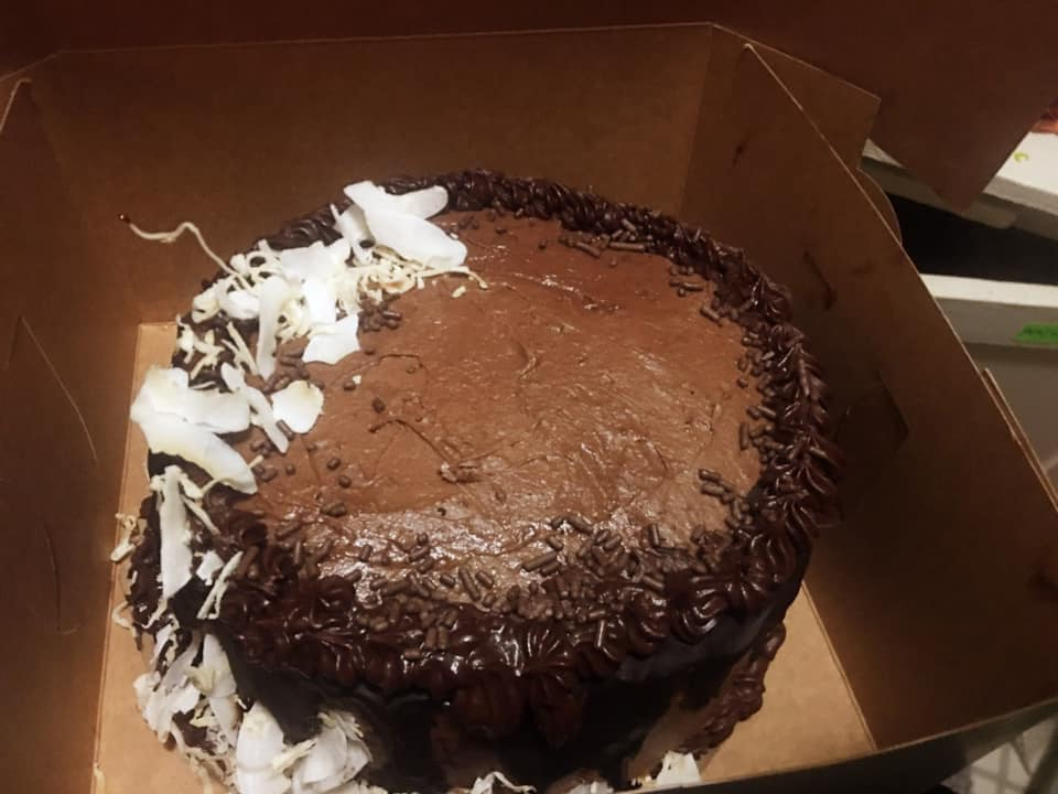 decedent vegan chocolate cake with a coconut ice cream center