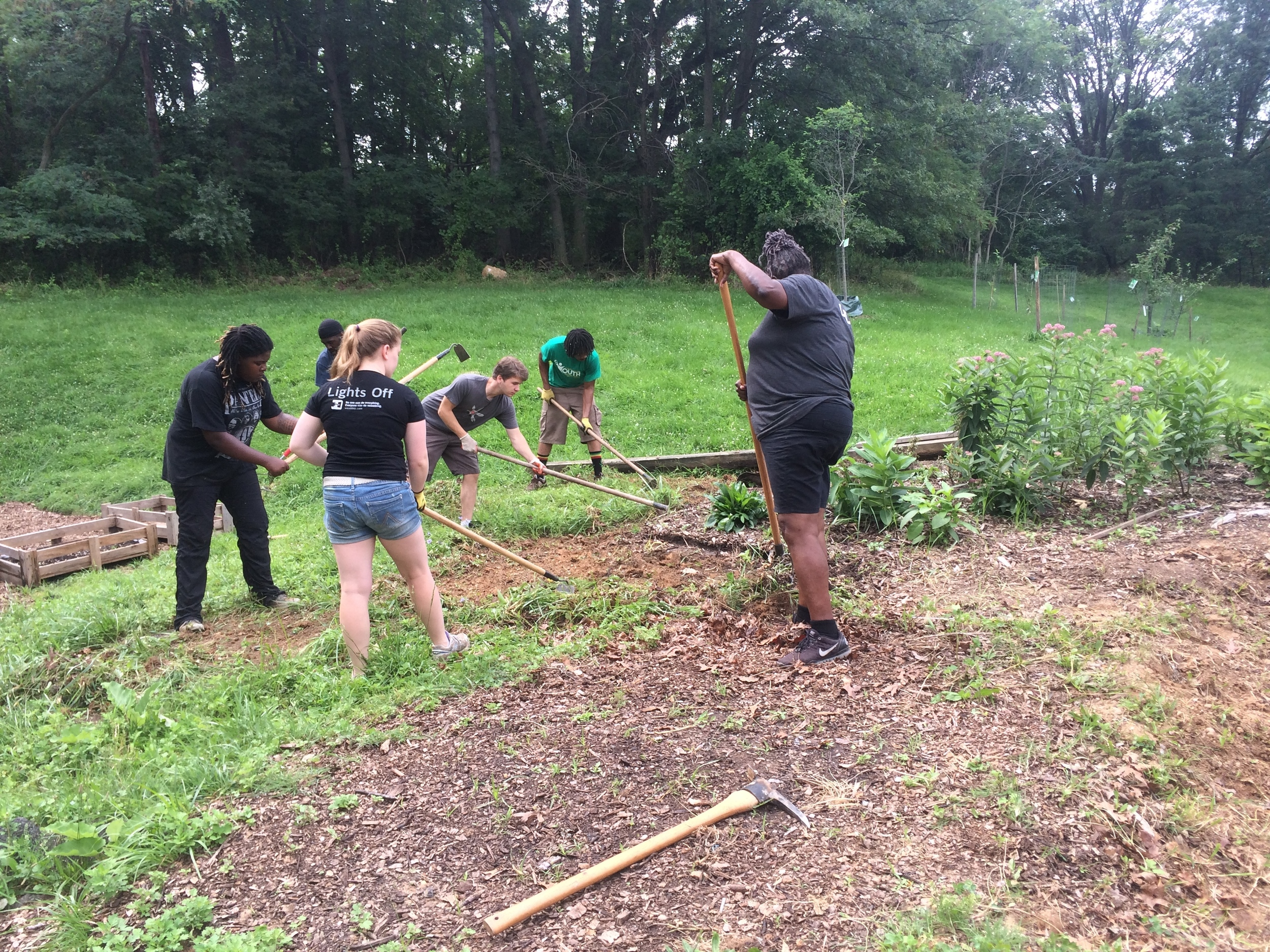 Summer Youth Interns working to expand our pollination garden with Mrs. Lelia