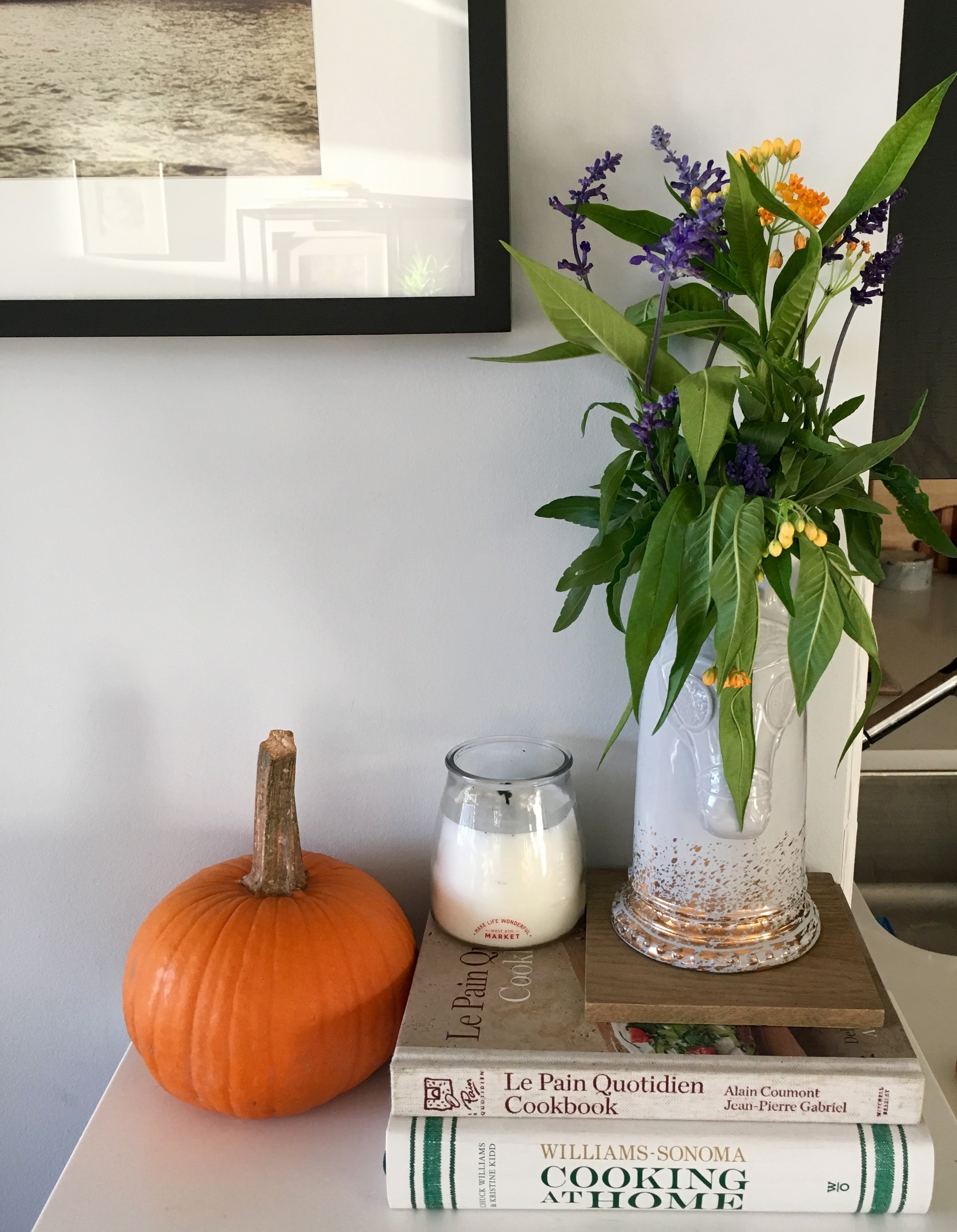 Our only orange pumpkin (plus my favorite Cedar & Lavender candle from  West Elm Market )