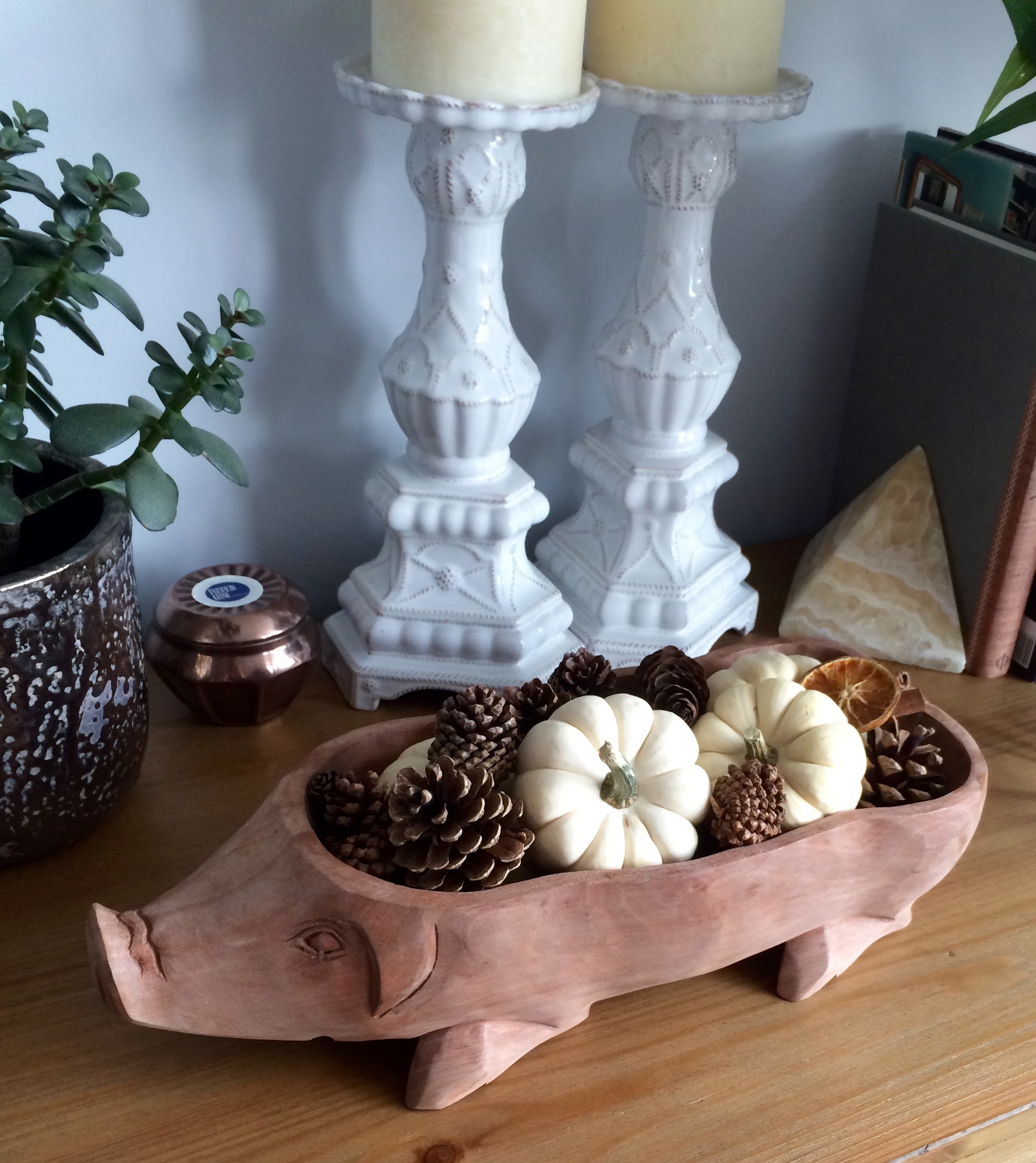 Pinecones, white pumpkins, and dried oranges on our sideboard.